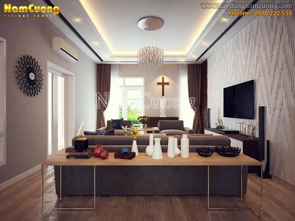 Không gian phòng khách có chiều sâu, ánh sáng tự nhiên và nhân tạo được cung cấp đầy đủ và hài hòa